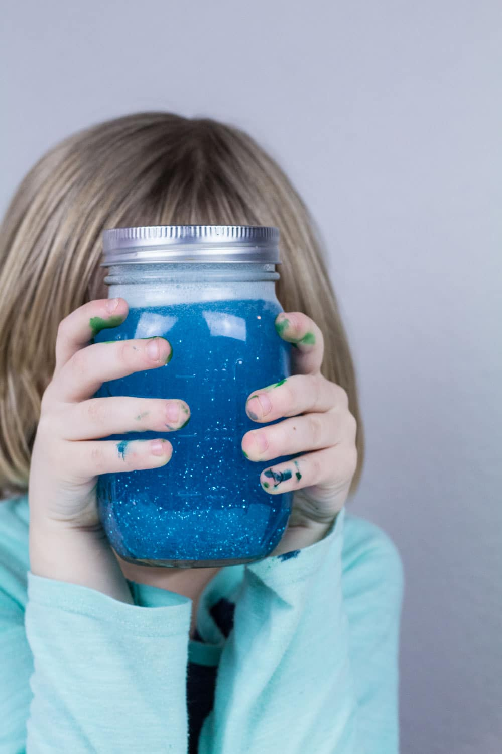Learn about science with a tornado in a jar! This tornado in a jar lesson plan is so easy and an excellent way to learn about centripetal force and makes an excellent tornado science project. Use our tornado in a jar worksheet to complete the glitter tornado science activity! #stemactivities #scienceexperimentsforkids #science #stem