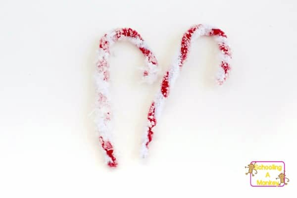 No science is more fun than candy cane science. But you don't have to have candy canes to make these salt crystal candy canes!