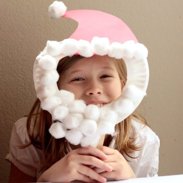 Kids will love this Santa hat craft where they make Santa face masks they can wear all Christmas vacation! This craft is so easy, kids can do it alone!