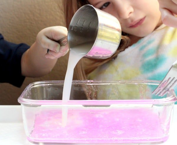 Nothing says Valentine's Day like pink and glitter. Mix them both in this fun Valentine's STEM activity making pink glitter slime!