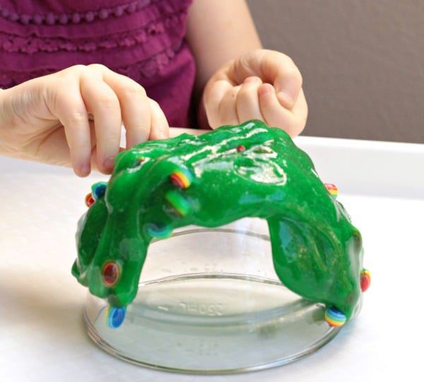 This rainbow bead sensory slime recipe is perfect for St. Patrick's Day or any time of year! Rainbow fun and stretchy slime fun!