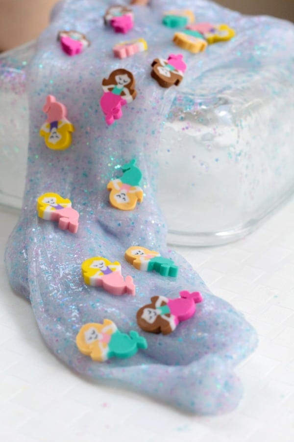 Mermaid slime made with sparkling glitter and mermaid erasers. The perfect awesome science experiment.
