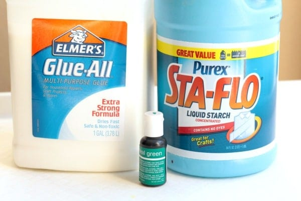 Ingredients to make slime: sta-flo laundry detergent, white Elmer's glue, and green food coloring.