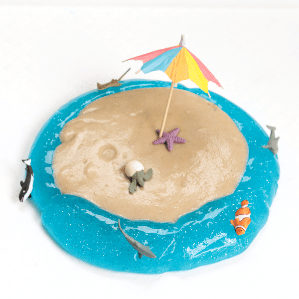 Transform ordinary sand slime into a thing of wonder with this beach sand slime recipe! Kids will love playing with this slime made with laundry starch.