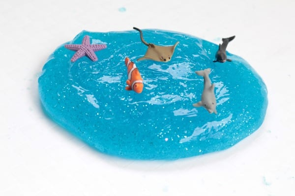 Blue ocean slime with small ocean fish on top.