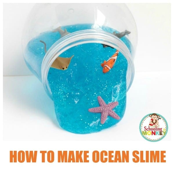 Blue glitter slime in a fishbowl with ocean creatures. A recipe for how to make ocean slime.