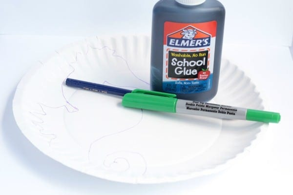 Supplies to make a paper plate seahorse. Black glue, markers, paper plate, and a pencil. Scissors not pictured.