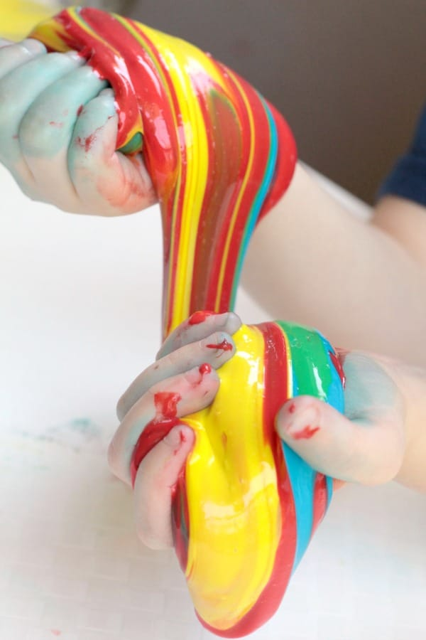 Slime is fun! Learn how to make tie dye slime in this fun variation on the classic liquid starch slime recipe. The perfect summer activity for kids!