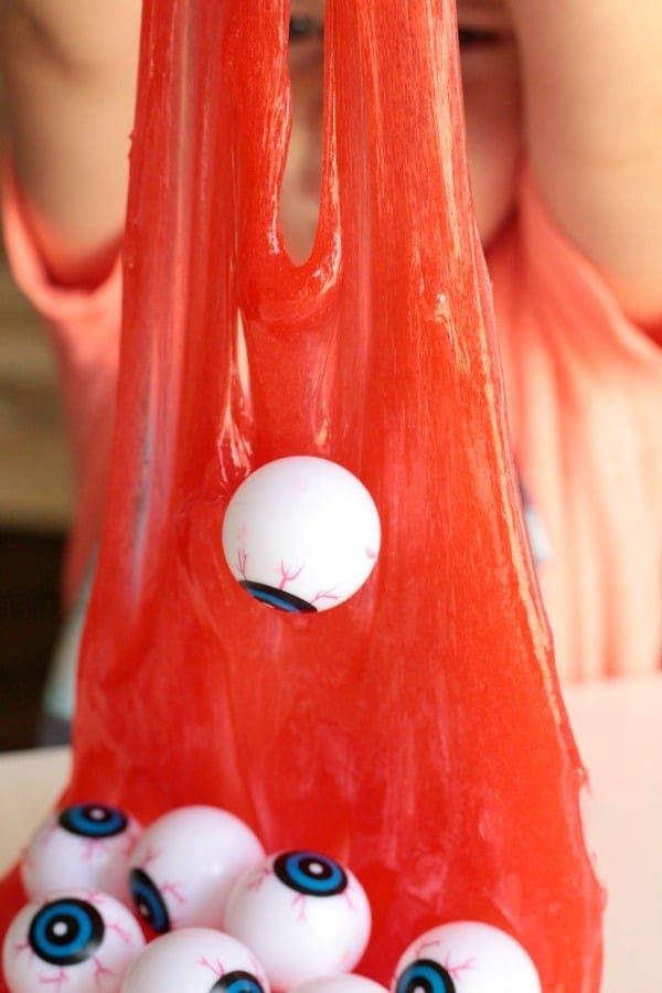 Looking for spooky science? This eyeball slime is the perfect gross science experiment to scare kids and make science the center of Halloween activities.