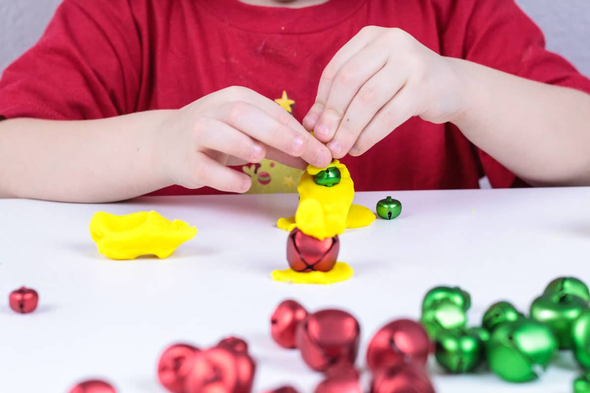 Make Christmas engineering accessible for preschool with this fun jingle bell engineering challenge! Christmas STEM activities have never been so fun!