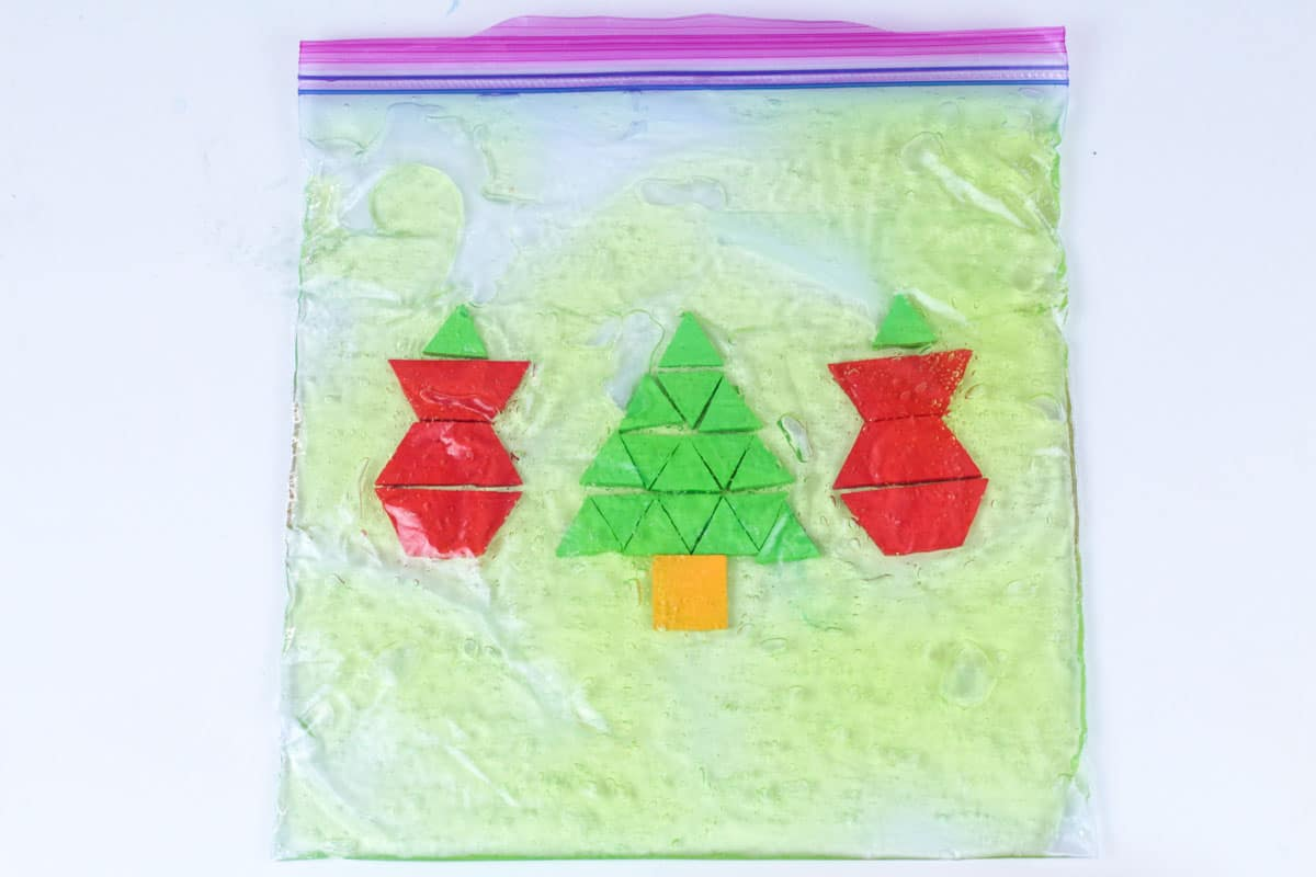 Make Christmas a fun sensory activity and math rolled into one with this Christmas pattern block sensory bag! Preschoolers will love this STEM activity!