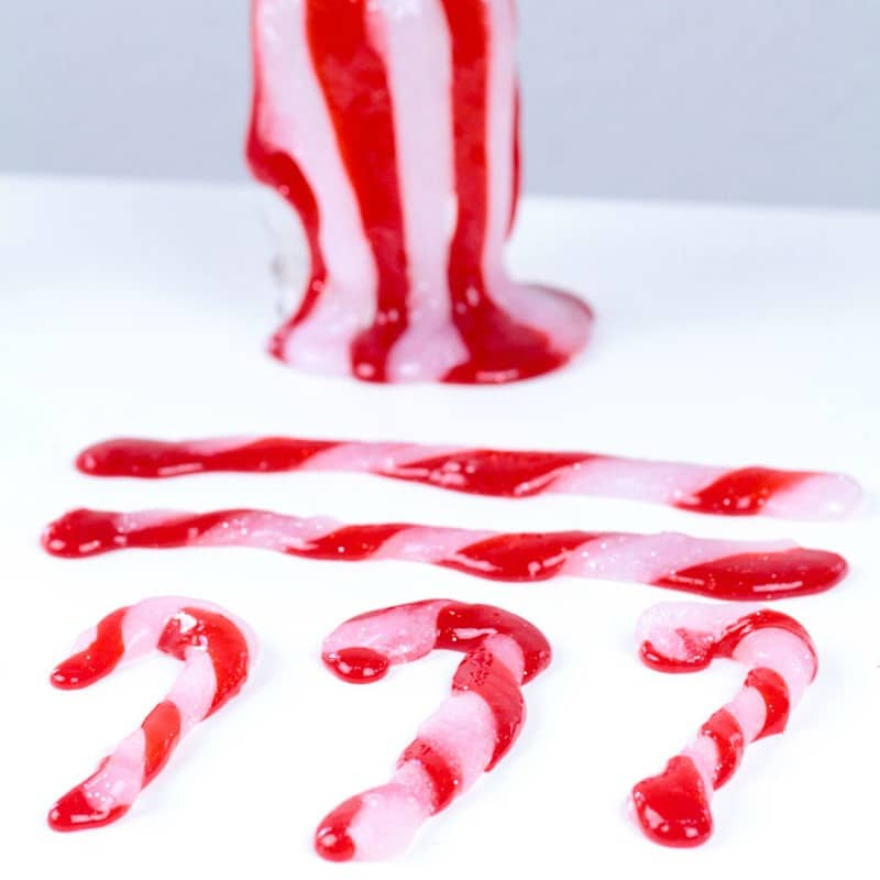 Mix Christmas and science with this fun Christmas STEM activity: making a candy cane slime recipe! Kids will love this hands-on science activity.