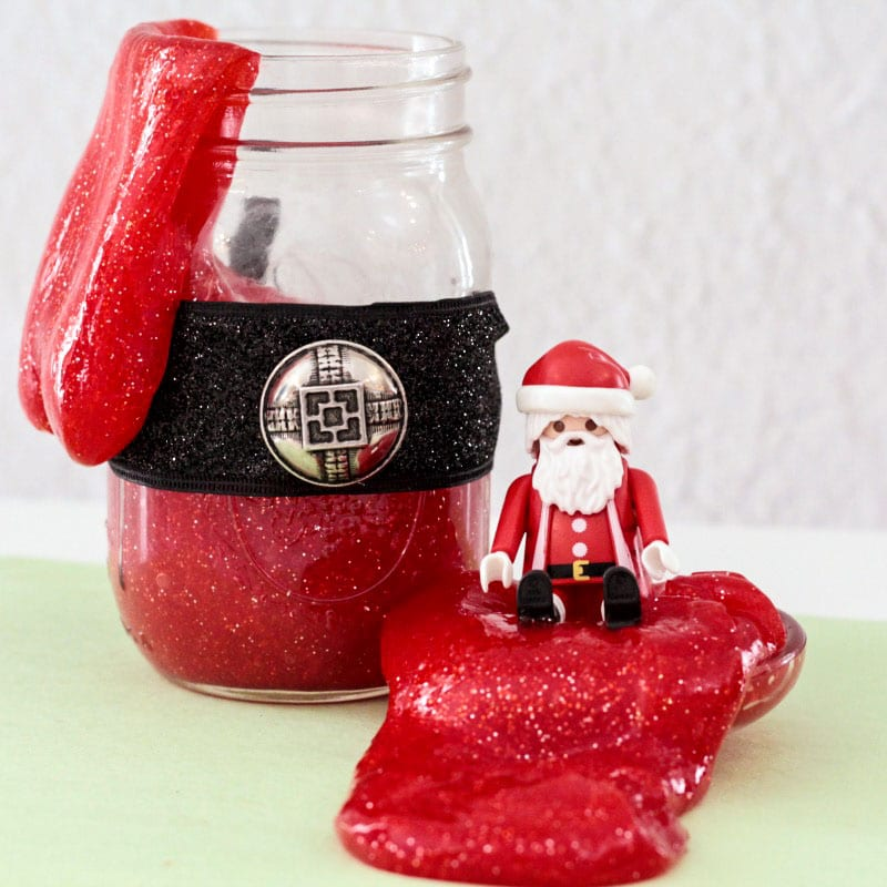 Make Santa come to life in a whole new way with this fun recipe for Santa suit slime! Christmas slime has never been so fun!