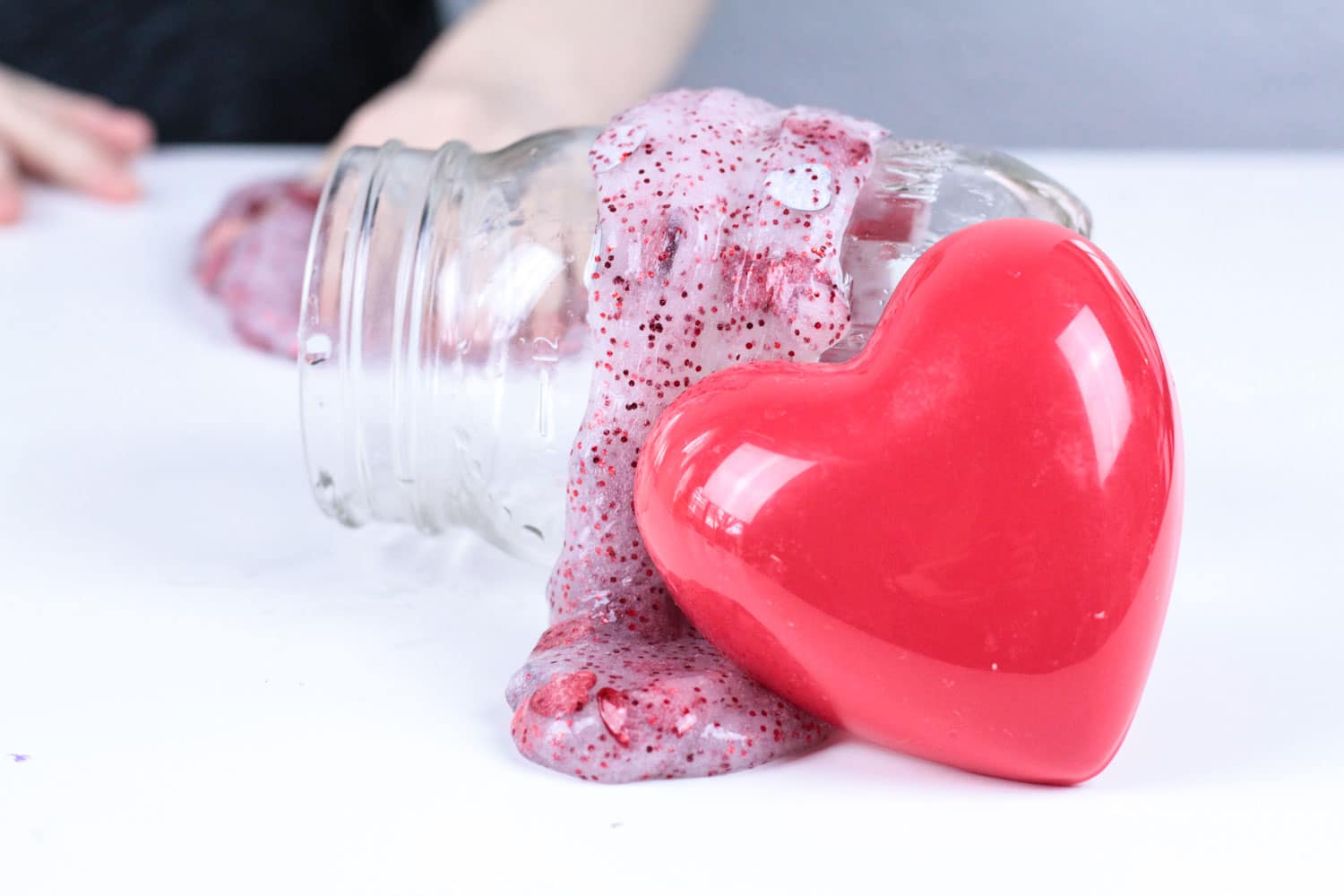 This Valentine's Day slime recipe is perfect for kids of all ages! Make this Valentine confetti slime as a non-candy valentine for your kid's class or make it in school as a Valentine STEM activity!
