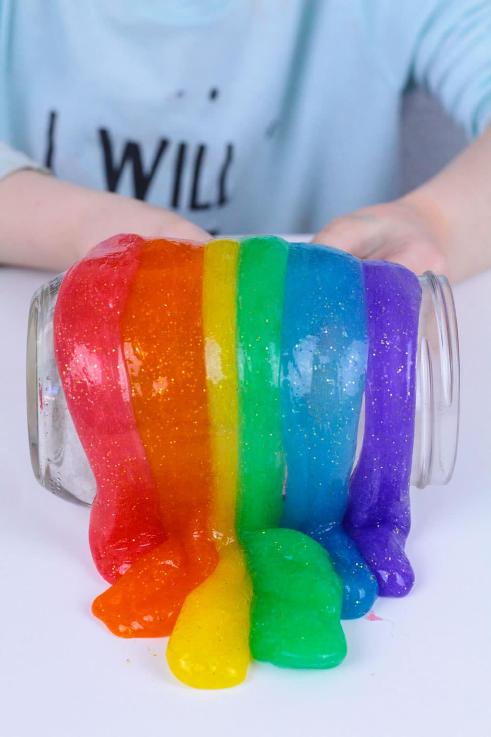 Love rainbows? Love glitter? Combine your loves in this beautiful glitter rainbow slime recipe! It's the perfect slime recipe for St. Patrick's Day or any time you need a burst of rainbow color in your classroom or home!
