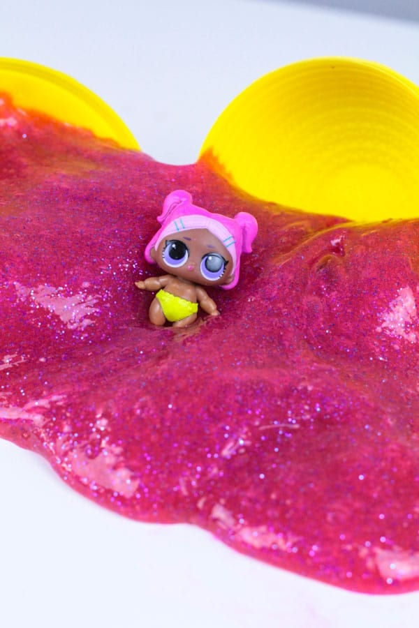 Do you love slime? Do you love LOL Dolls? Make this super fun LOL Doll slime that kids will love! This LOL Doll slime recipe makes a fun LOL Doll party favor and kids will love this new twist on LOL surprise dolls! There is so much fun with slime and LOL surprise dolls!