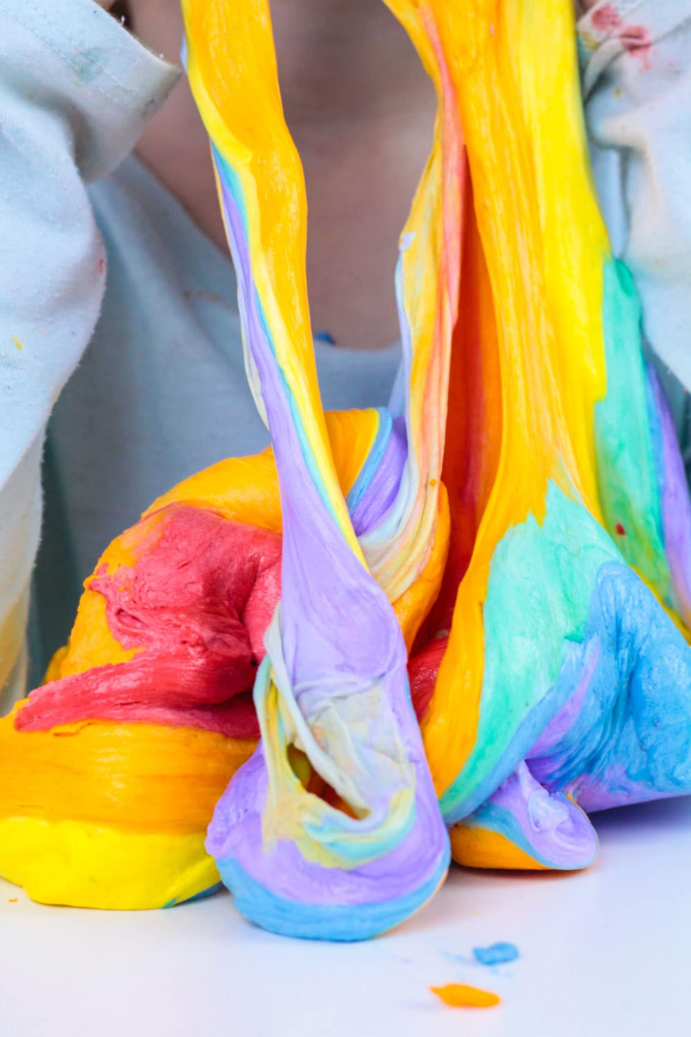 Slime lovers will adore this fluffy version of rainbow slime! This fluffy rainbow slime recipe is super easy to make and it's less messy than many other slime recipes out there. Rainbow slime that is fluffy is fun and you'll learn how to make fluffy rainbow slime in no time!