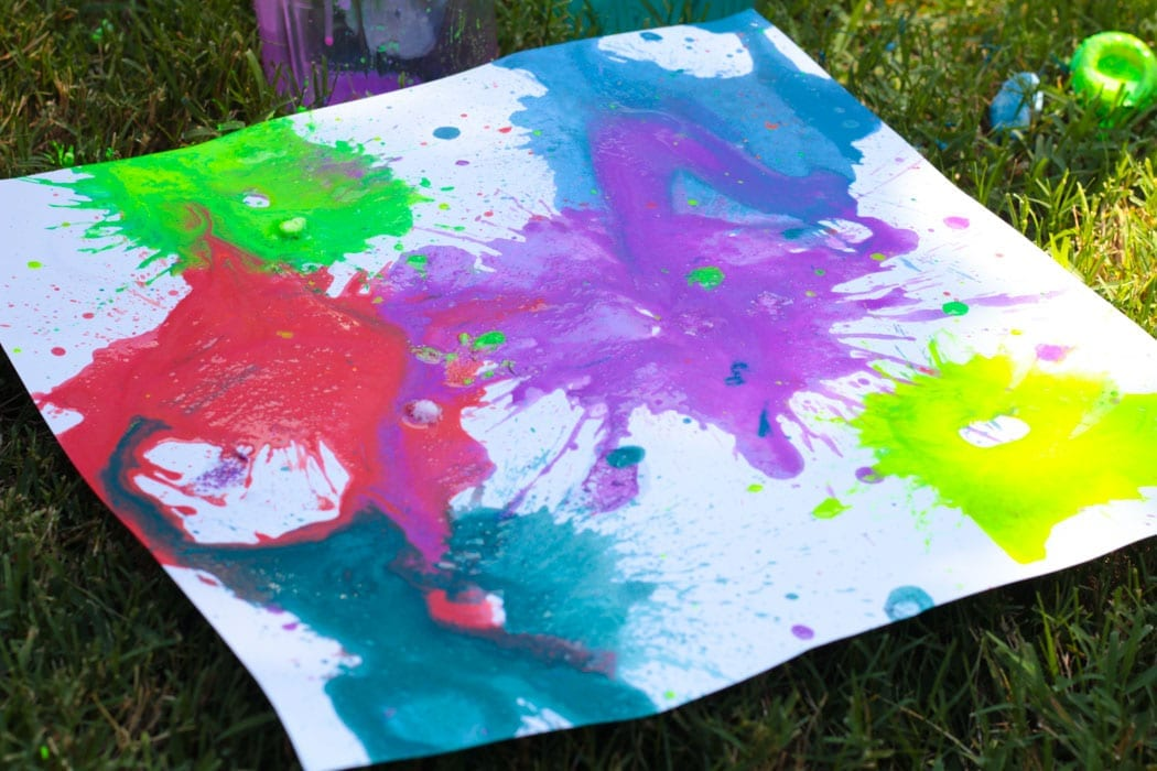 Make your own exploding paint projects in this super fun and educational STEM activity for kids! Make your summer activities filled with color and light when you try the exploding paint rockets STEAM challenge. How far can you get your exploding film canister rockets to fly? #stemed #stem #steamprojects #stemactivities #STEAM #kidsactivities #summerlearning #summerfun #scienceexperiments