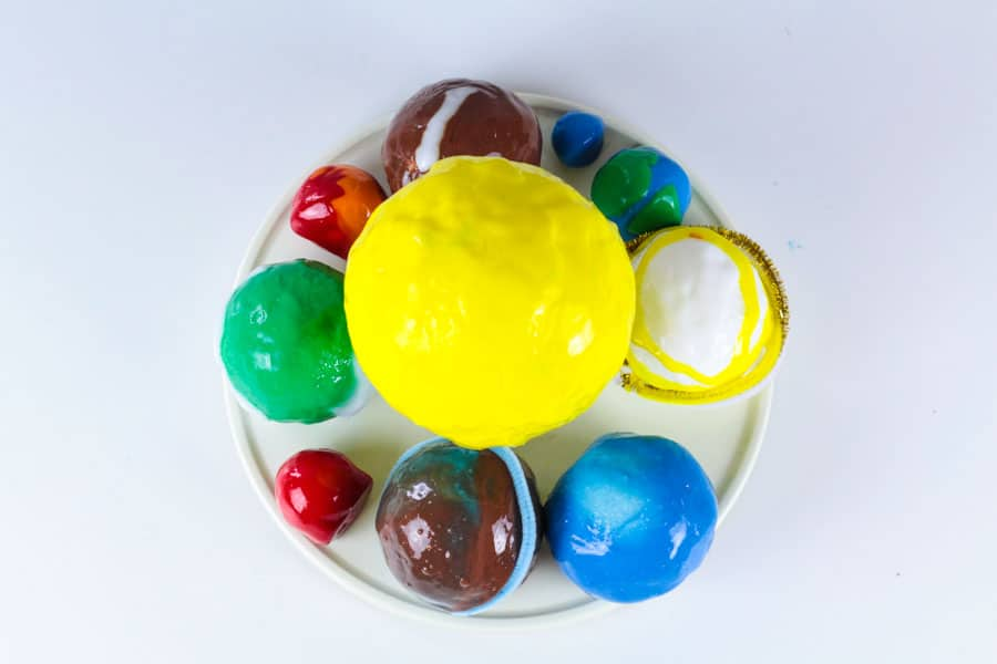 Make slime educational by making this slime model of the solar system! The solar system slime recipe is a fun way to combine space learning and slime play in one! Make learning the planets fun with this educational slime activity for kids. It's the perfect activity for a space theme!