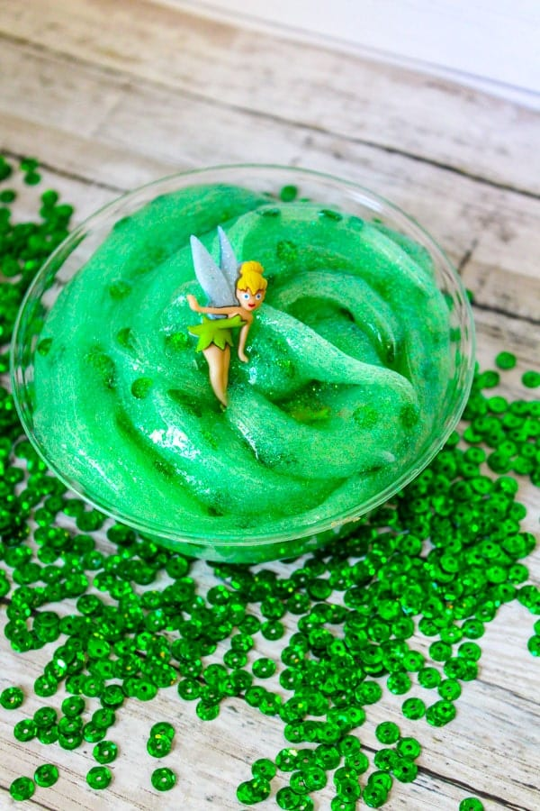 If you love making slime and you love Disney, you'll love this super fun Tinkerbell slime recipe. Bring Tinkerbell to life with this easy slime recipe that kids will love. It's perfect for a Tinkerbell party favor and is one of our favorite Disney slime recipes. #tinkerbell #disney #slime #slimerecipes #slimer