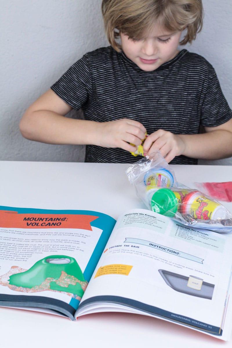 Kindergarten girl opens Bookshark Hands on History kit