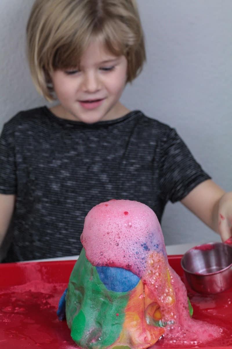 Girl makes playdough volcano erupt