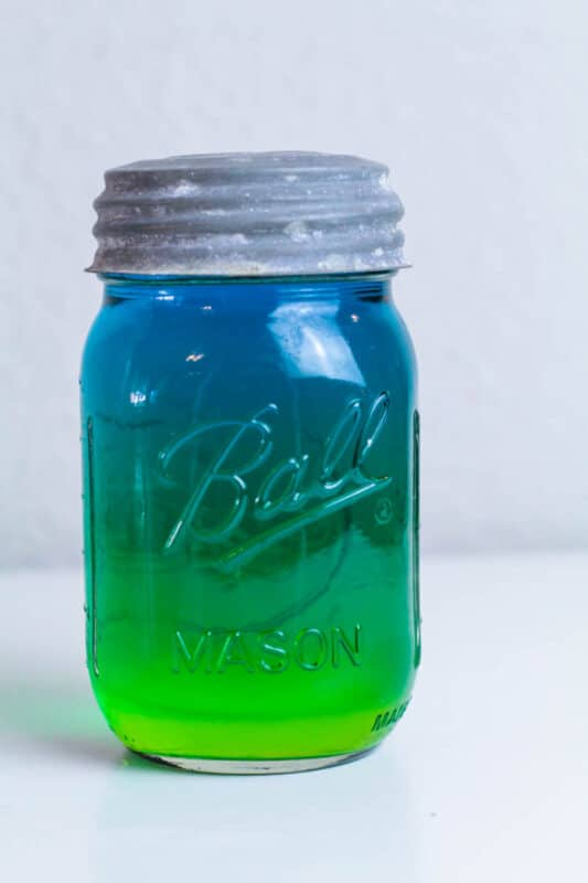 sugar density tower science experiment in a jar with blue and green water fortnite slurp drink inspired