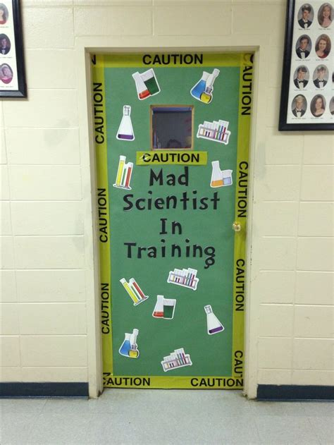 "a Halloween classroom door that is decorated with science tools and says ""mad scientists in training"""