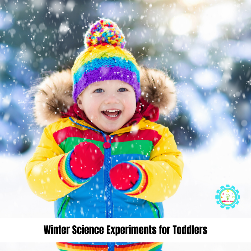 toddler in colorful jacket doing science experiments